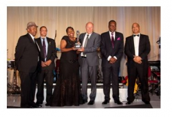 G.U.D.Holdings:Red Shuttleworth, G.U.D. Holdings (4th left) accepts the award with joint winner Nosipho Siwisa-Damasane, Chief Executive of Richards Bay Coal Terminal.
