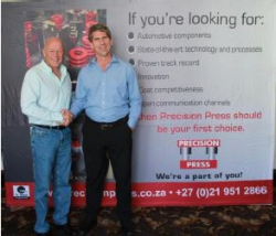 Red Shuttleworth, CEO of G.U.D. Holdings and Simon Ledgerwood, Managing Director of Precision Press celebrates the new merger