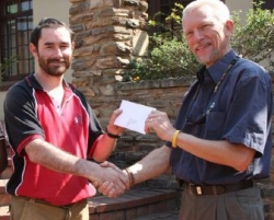 NCT Forestry:Rob Thompson (right), NCT's Assistant GM, presents a cheque for R80 000 to Dr Ian Little of the Endangered Wildlife Trust.