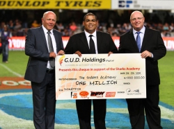 G.U.D. Holdings - (Left to right) Red Shuttleworth, CEO (left) and Ian Law (right), Sales & Marketing Director of G.U.D. Holdings presents the cheque to Etienne Fynn, Managing Director of the Sharks Academy (centre) Photo courtesy of The Sharks